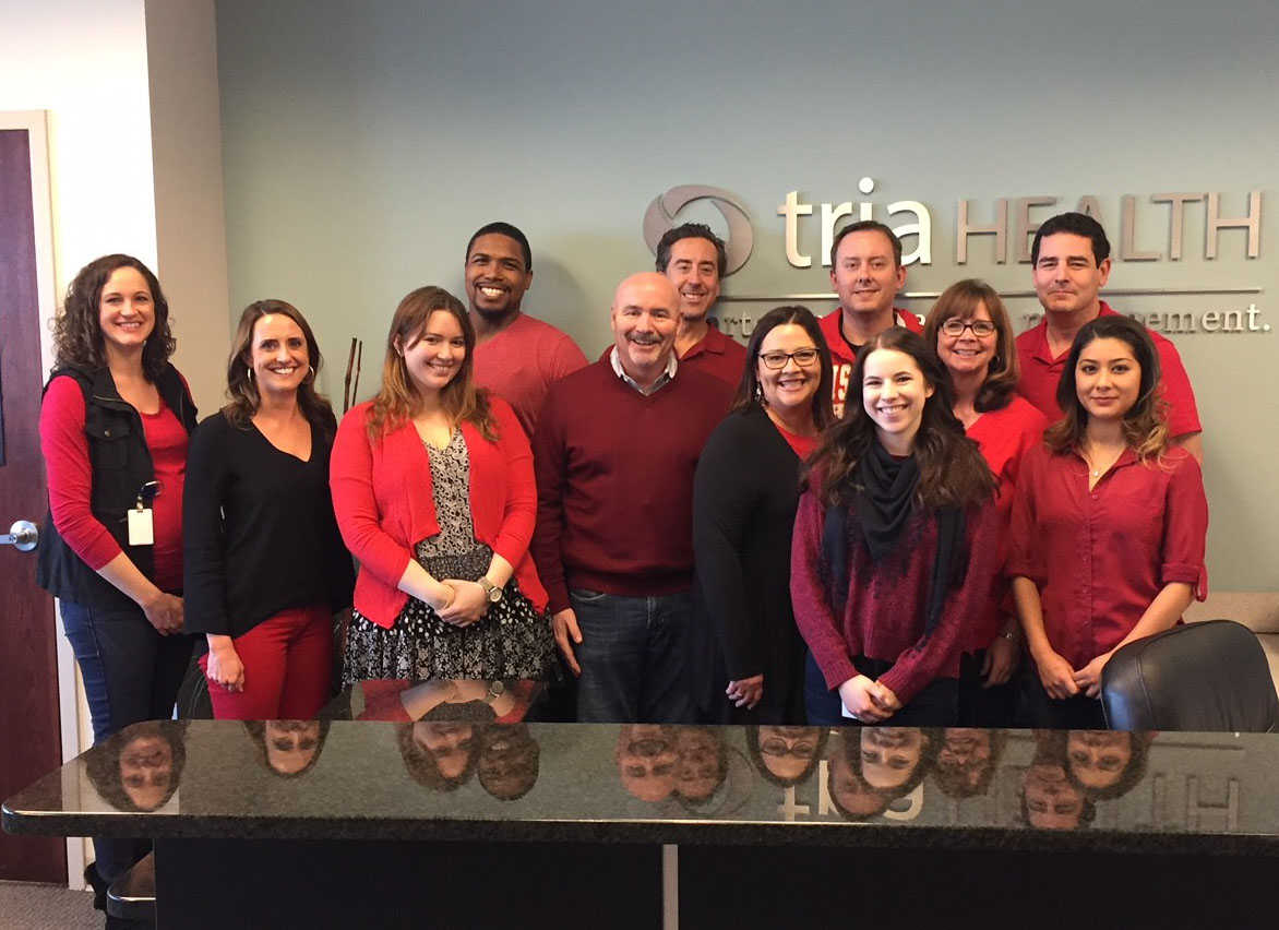 Tria Health Employees Wearing Red