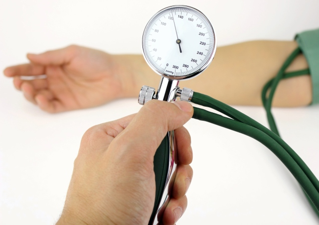 Man checking blood pressure with bp cuff