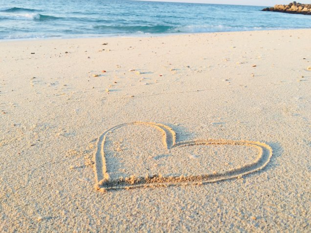 Heart outline in the sand near the ocean