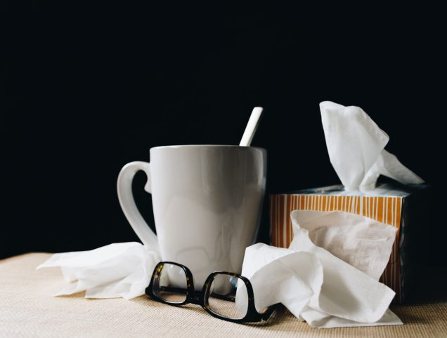 Mug surrounded by tissues